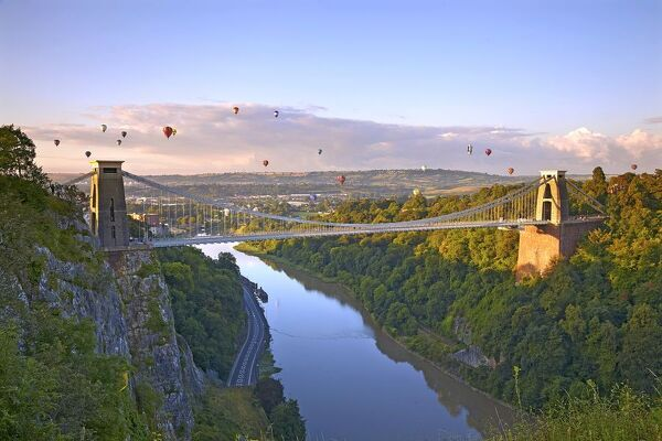Clifton Suspension Bridge with hot air balloons in the Bristol Balloon Fiesta in August
