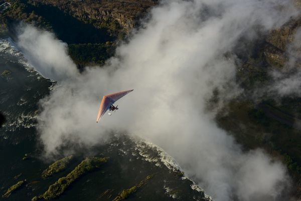 Aerial view of a micorlight (ultralight) flying over the Zambezi River and Victoria Falls. Livingstone. Zambia