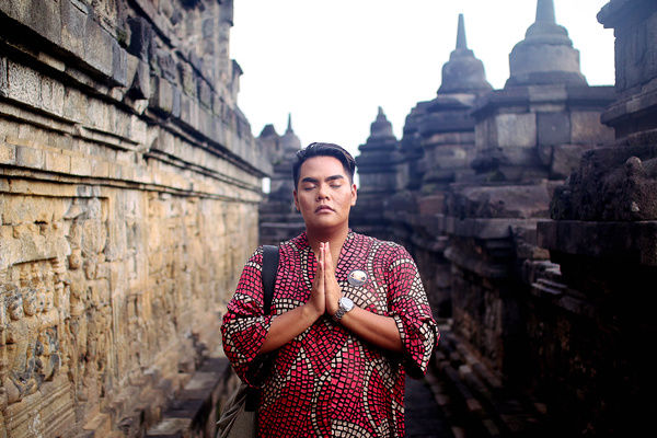 Asian man in traditional dress posed at Borobudur temple